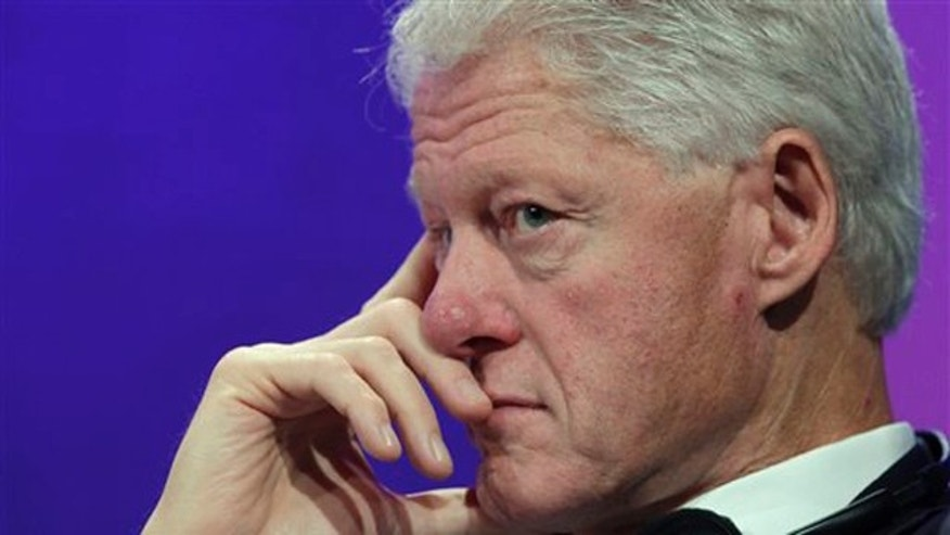 Former President Bill Clinton listens to a panel discussion on climate change at the Clinton Global Initiative Sept. 20 in New York.