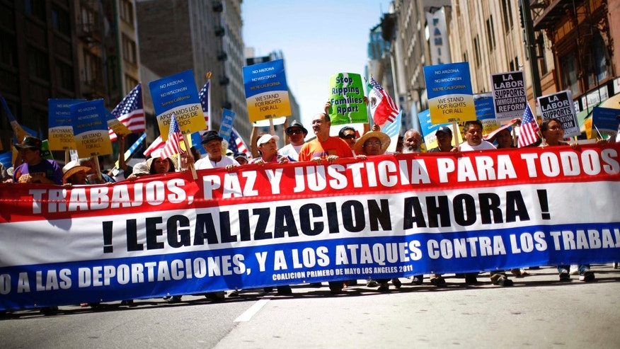 LOS ANGELES, CA - MAY 1:  Demonstrators march during a May Day protest May 1, 2011 in Los Angeles, California. Thousands of people marched for immigration reform, among other issues. (Photo by Eric Thayer/Getty Images)
