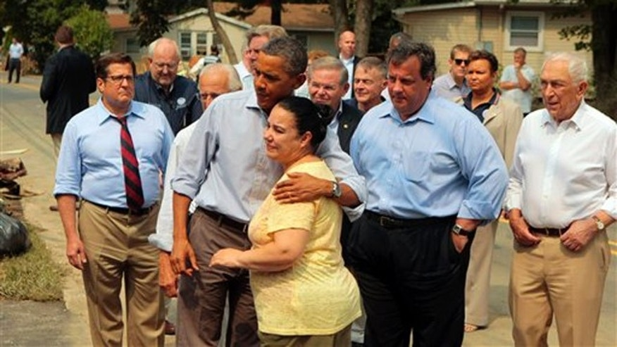 President Obama hugs a woman on a flood damaged street in Wayne, N.J., as he visits areas damaged by Hurricane Irene Sept. 4. At right is New Jersey Gov. Chris Christie.