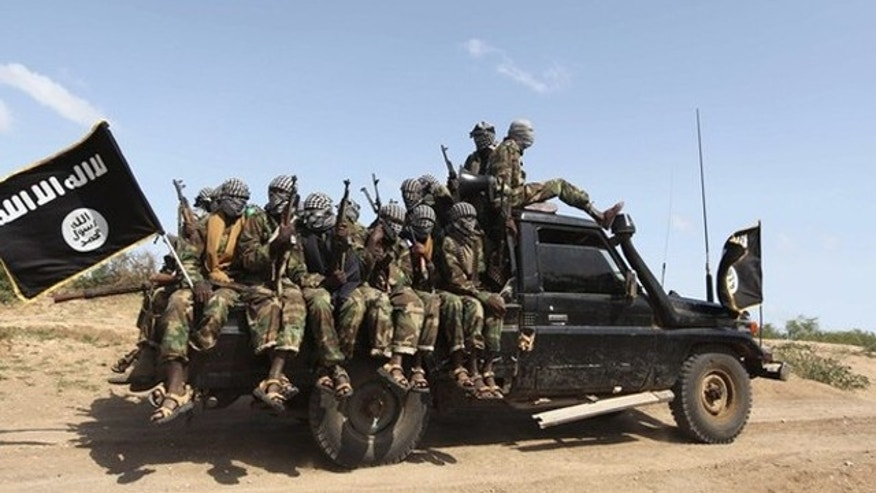 Members of al Shabaab, al Qaeda-linked insurgents, ride in their pick-up trucks after distributing relief to famine-stricken people outside Mogadishu, Somalia, Sept. 3.