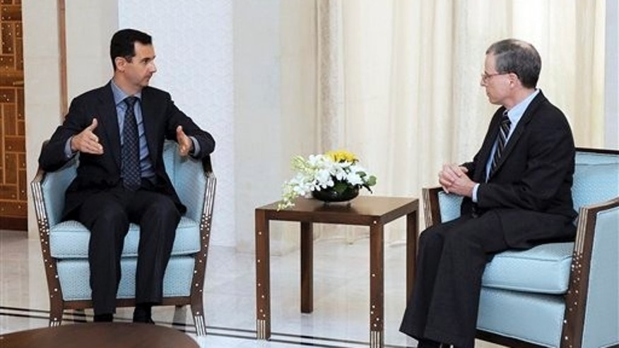 Jan. 27, 2011: Syrian President Bashar Assad, left, meets with Robert Ford, the U.S. ambassador to Syria, in Damascus, Syria.