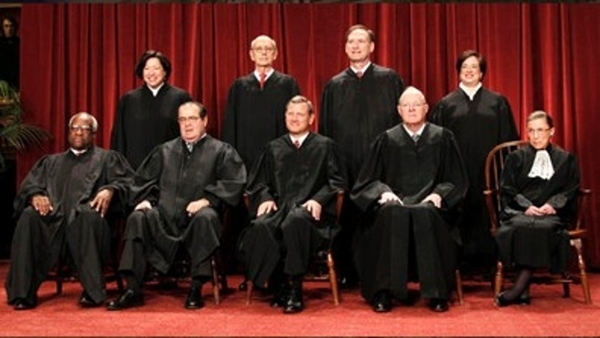 FILE: In this Oct. 8, 2010, file photo, members of the Supreme Court gather for a group portrait at the Supreme Court in Washington. Seated from left are: Associate Justices Clarence Thomas, Antonin Scalia, Chief Justice John Roberts, Associate Justices Anthony M. Kennedy, and Ruth Bader Ginsburg. Standing, from left are: Associate Justices Sonia Sotomayor, Stephen Breyer, Samuel Alito Jr., and Elena Kagan.