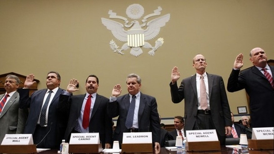 "Witnesses are sworn in at a hearing held by the House Oversight and Government Reform Committee on ""Operation Fast and Furious: The Other Side of the Border,"" on Capitol Hill in Washington, July 26, 2011."