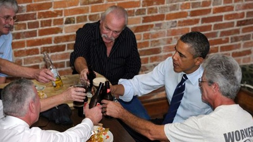 Oct. 11: President Barack Obama has a beer with unemployed construction workers at The Harp and Celt Irish Bar in Orlando, Fla.