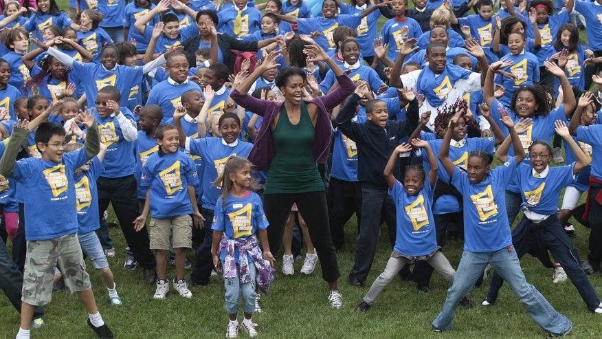 First Lady, 400 School Kids Kick Off Jumping Jack Record Attempt at White House