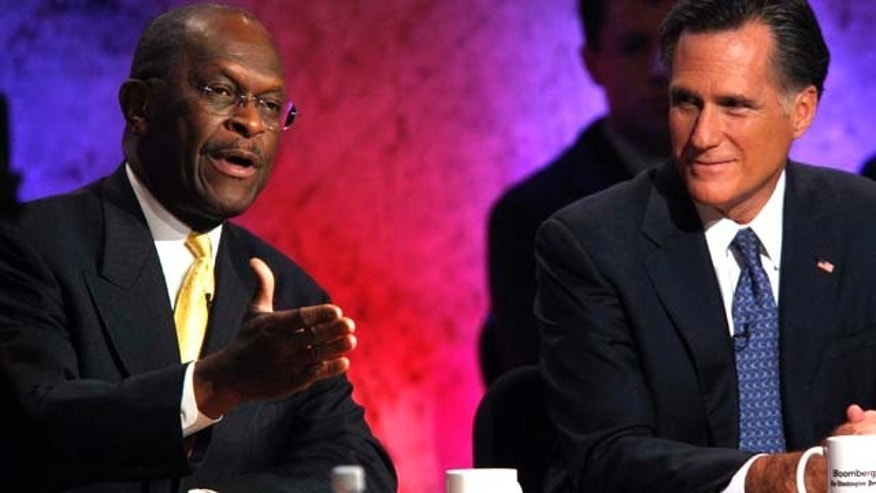 Republican presidential candidates businessman Herman Cain speaks as former Massachusetts Gov. Mitt Romney listens during a Republican presidential debate at Dartmouth College in Hanover, N.H., Tuesday, Oct. 11, 2011.