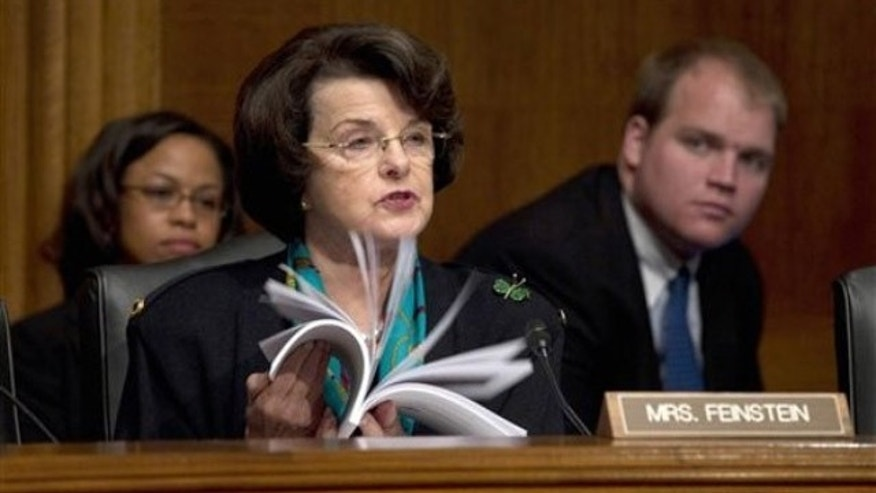 Sen. Dianne Feinstein thumbs through documents as she speaks on Capitol Hill in Washington Oct. 4.