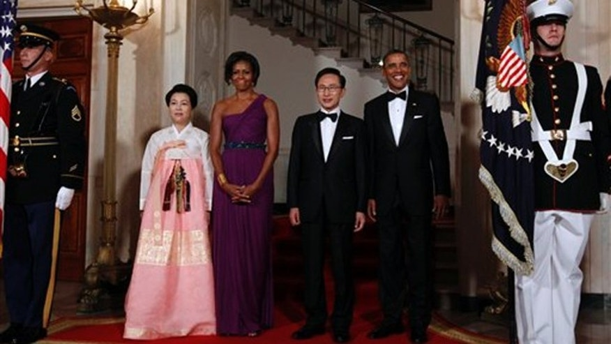 President Barack Obama and first lady Michelle Obama pose with South Korean President Lee Myung-bak and his wife Kim Yoon-ok at the North Portico of the White House in Washington, Thursday, Oct., 13, 2011, prior to a State Dinner.