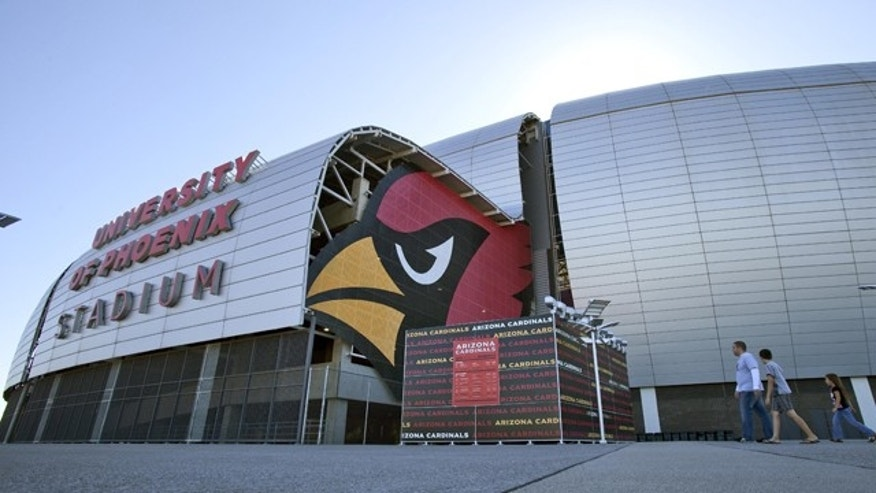Oct. 11: Pedestrians walk outside of the University of Phoenix Stadium in Glendale, Ariz.