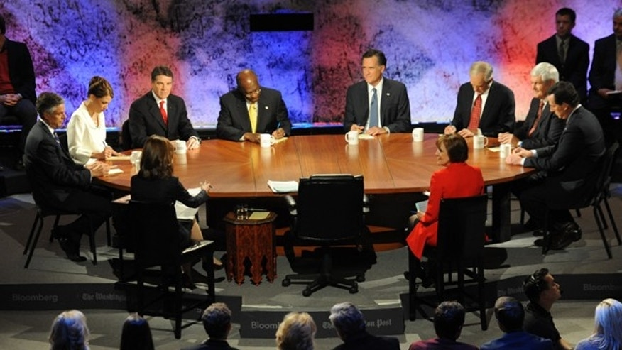 Oct. 11: Republican presidential candidates from left facing camera, former Utah Gov. Jon Huntsman, Rep. Michele Bachmann, R-Minn., Texas Gov. Rick Perry, businessman Herman Cain, former Massachusetts Gov. Mitt Romney, Rep. Ron Paul, R-Texas, former House Speaker Newt Gingrich and former Pennsylvania Sen. Rick Santorum participate in a presidential debate at Dartmouth College in Hanover, N.H.