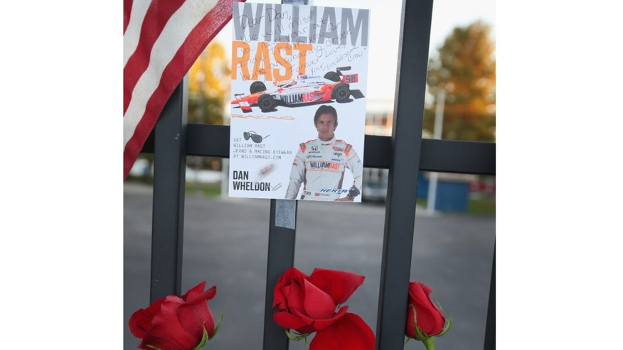 INDIANAPOLIS, IN - OCTOBER 17: Roses are left at the gate of the Indianapolis Motor Speedway along with other tributes left by fans to two-time Indianapolis 500 winner Dan Wheldon on October 17, 2011 in Indianapolis, Indiana. Wheldon, winner of the 2011 Indy 500, was killed in a crash yesterday at the Izod IndyCar series season finale at Las Vegas Motor Speedway.  (Photo by Scott Olson/Getty Images)
