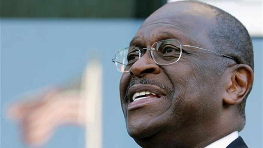 Presidential candidate Herman Cain speaks with the media after an interview in Washington, D.C., on Oct. 16.