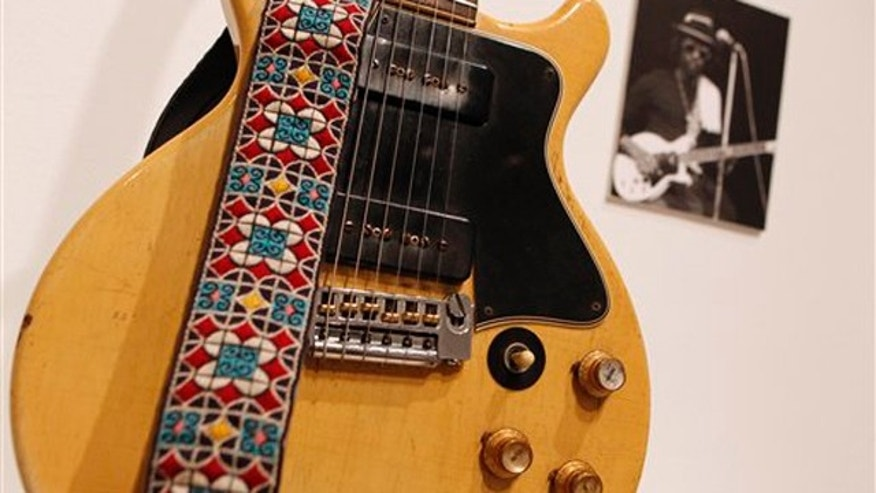 Oct. 6, 2011: A 1960 Gibson Les Paul Special, formerly owned by reggae musician Peter Tosh, is displayed in New York.