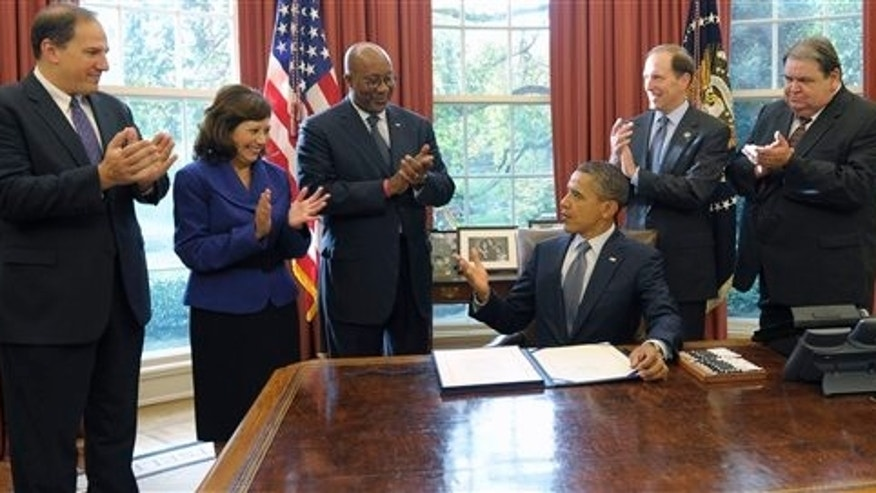 October 21: President Barack Obama speaks in the Oval Office of the White House. From left are, Deputy Labor Secretary Seth Harris, Labor Secretary Hilda Solis, US Trade Representative Ron Kirk, Rep. Dave Camp, R-Mich., and United Steelworkers Vice President Thomas Conway.