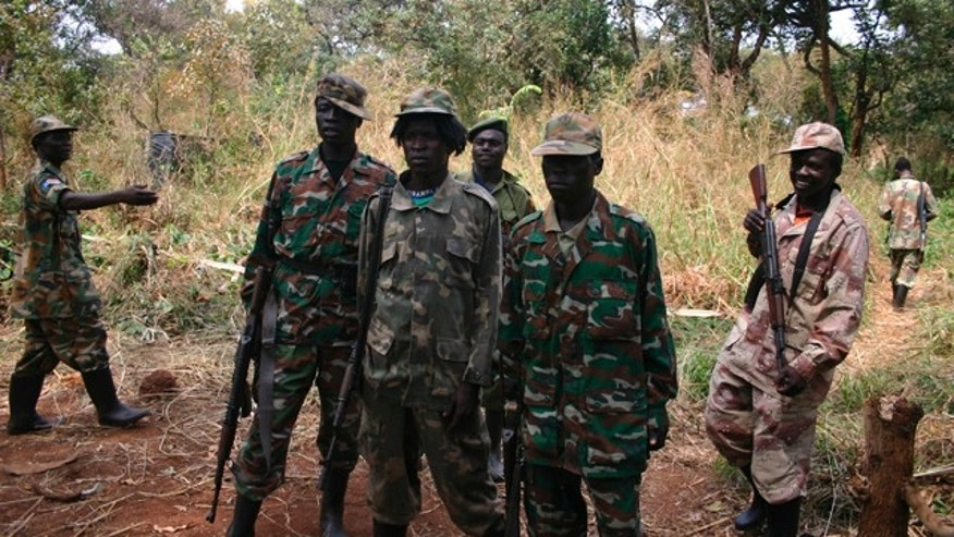 Lord's Resistance Army soldiers pose during peace negotiations between the LRA and Ugandan religious and cultural leaders in southern Sudan. (AP)