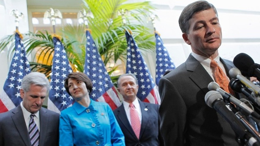 FILE: In this Oct. 25, 2011, photo, Rep. Jeb Hensarling, R-Texas, right, says the so-called Super Committee which he co-chairs still has plenty of time to find a solution to the nation's debt crisis. That time is now ticking down to little more than a week.