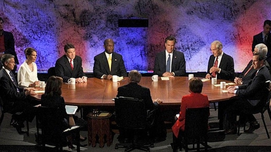 October 11, 2011: Republican presidential candidates from left facing camera participate in a presidential debate at Dartmouth College in Hanover, N.H., Tuesday, Oct. 11, 2011.