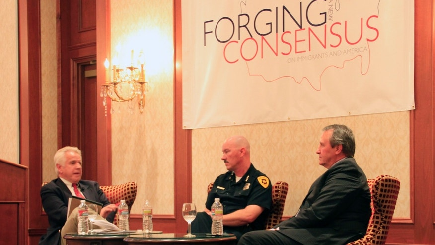 Doug Wright (left), a Utah radio show host, moderates a panel with Salt Lake City Police Chief Chris Burbank (middle), and Utah Attorney General Mark Shurtleff (right), as they discuss the effects that an enforcement-only immigration policy would have on police.