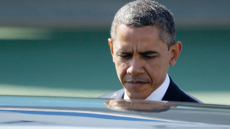 President Obama prepares to enter his limousine after arriving at San Francisco International airport in San Francisco, Tuesday, Oct. 25, 2011.