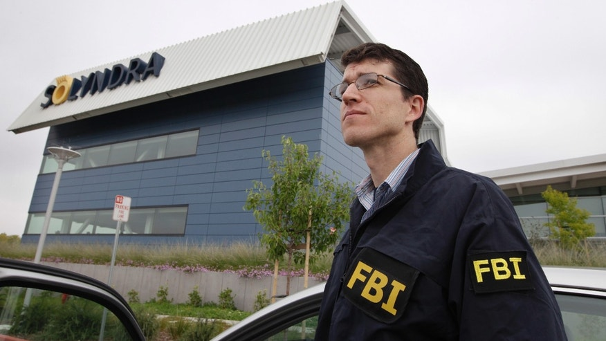 Sept. 8, 2011: FBI agents stand guard outside of Solyndra headquarters in Fremont, Calif. The FBI executed search warrants at the headquarters of California solar firm Solyndra that received a $535 million loan from the federal government.