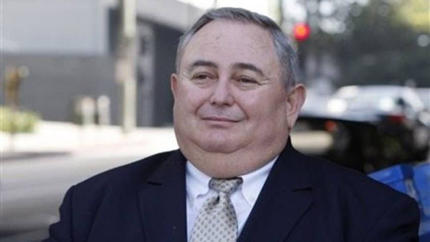 March 30, 2011: Former Bell City Manager Robert Rizzo leaves a court arraignment in Los Angeles.