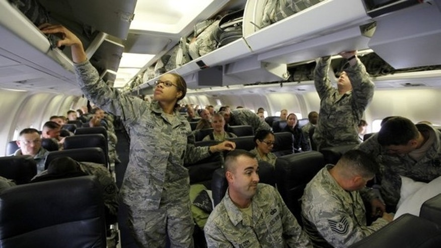 Members of the U.S. Air Force stow their bags in a plane at al-Asad air base in Iraq's western province of Anbar November 1, 2011, before flying to the U.S.. U.S.