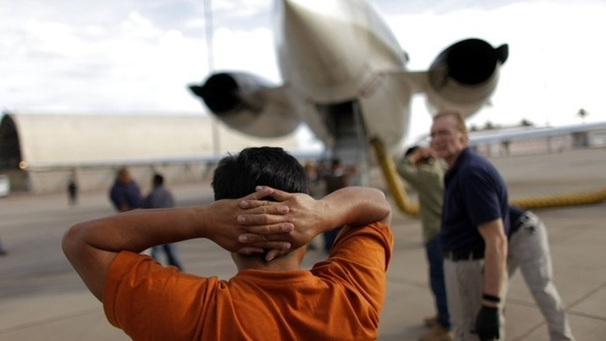 July 10, 2009: A Guatemalan illegal immigrant prepares to board a plane at the Phoenix-Mesa Gateway airport during his deportation process.