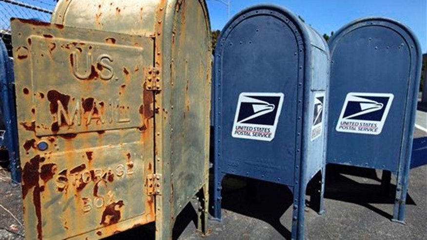 Postal Service mailboxes are seen awaiting disposal Sept. 1 in San Jose, Calif.