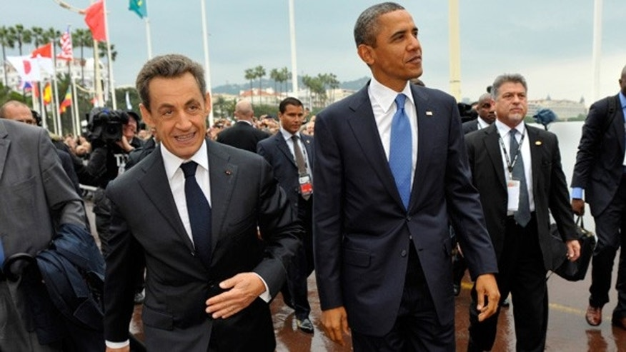 Nov. 3: French President Nicolas Sarkozy, left, and US President Barack Obama walk together during arrivals for the G20 summit in Cannes, France.