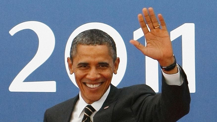 President Obama waves as he arrives for a G20 summit in Cannes, France on Friday, Nov. 4, 2011.