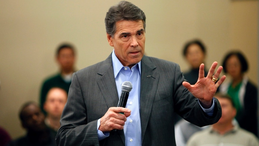 Republican presidential candidate Texas Gov. Rick Perry speaks during a town hall meeting with employees at Pioneer Hi-Bred, Thursday, Nov. 3, 2011, in Johnston, Iowa. (AP Photo/Charlie Neibergall)