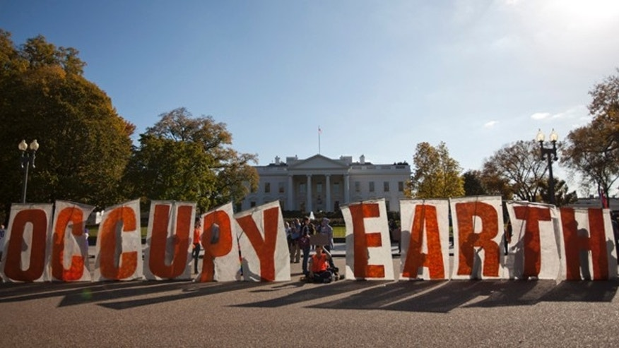 Nov. 6, 2011: Demonstrators gather during a protest against the Keystone XL Pipeline outside the White House.