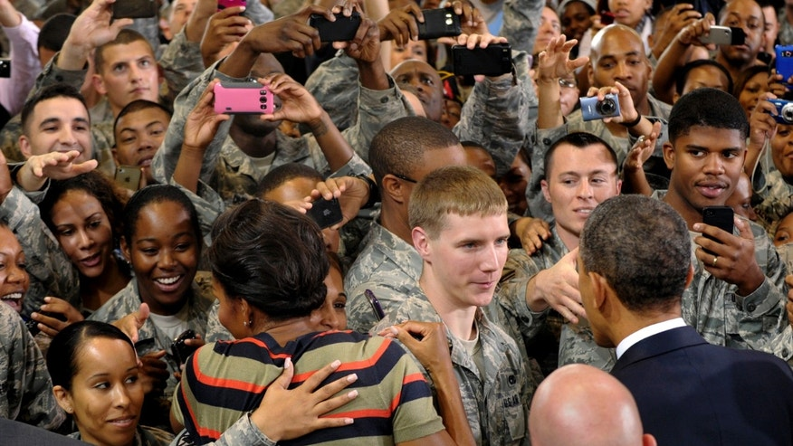 Oct. 19, 2011: President Obama and first lady Michelle Obama meet troops during a stop at Joint Base Langley-Eustis, in Hampton, Va.