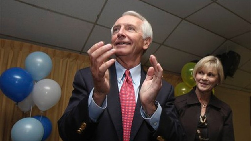 Kentucky Gov. Steve Beshear, left, and his wife Jane watch as Democrats are recognized during a rally at the American Legion Hall on Bardstown Road in Louisville, Ky., Monday, Nov. 7, 2011.