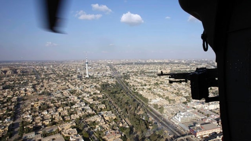 A U.S. Army Black Hawk helicopter flies over the city of Baghdad, Iraq, Monday, Nov. 7, 2011.  The U.S. has promised to withdraw from Iraq by the end of the year as required by a 2008 security agreement between Washington and Baghdad. Some 39,000 U.S. troops are scheduled to clear out along with their equipment. (AP Photo/Khalid Mohammed)