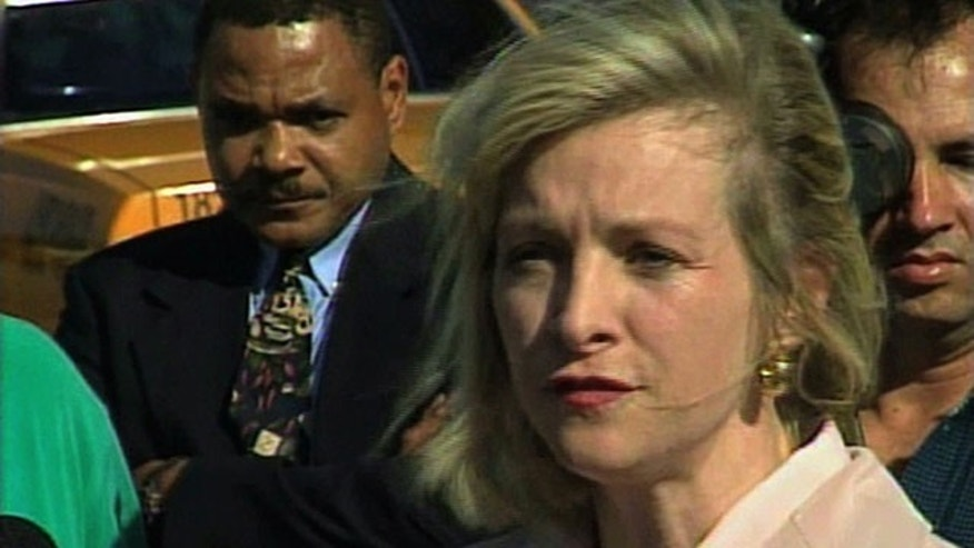 FILE - This March 2000 image from video shows then-Immigration and Naturalization Service spokesperson Karen Kraushaar at a news conference in Miami regarding Elian Gonzalez. The Associated Press has chosen to publish Kraushaar's name, after independently confirming she was one of the accusers who filed sexual harassment complaints against Herman Cain when she and Cain worked at a restaurant trade group.