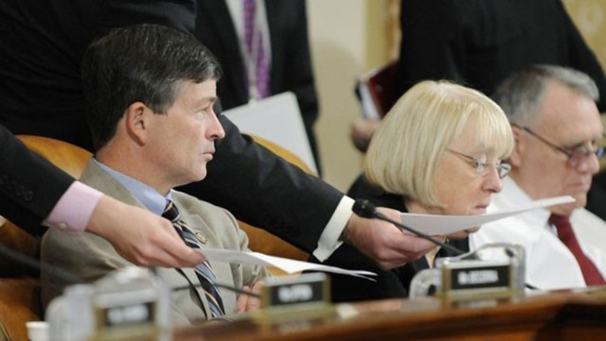 November 1, 2011: Aides deliver papers to co-chairmen Rep. Jeb Hensarling (R-TX) (L) and Senator Patty Murray (D-WA) during a hearing of the U.S. Joint Select Committee on Deficit Reduction on Capitol Hill in Washington.