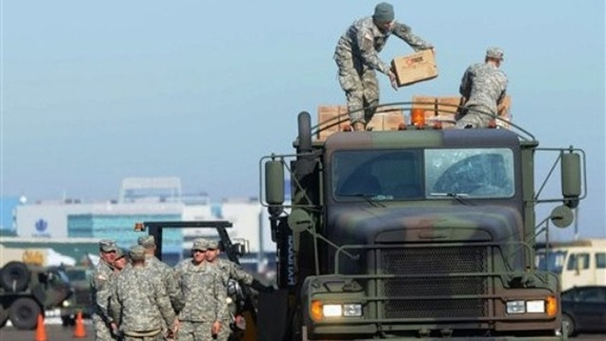 Nov. 2, 2011: Members of Connecticut National Guard Air Force and Army load pallets of MRE's (Made Ready to Eat) and bottled water onto a military truck to shipped out to towns and communities affected by power outage at Rentschler Field, in East Hartford, Conn.