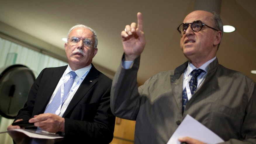 Oct. 31, 2011: Palestinian Foreign Minister Riad al-Maliki, left, is seen with historian and Ambassador for Palestine at UNESCO Elias Sanbar, left, during a session of UNESCO's 36th General Conference, in Paris.
