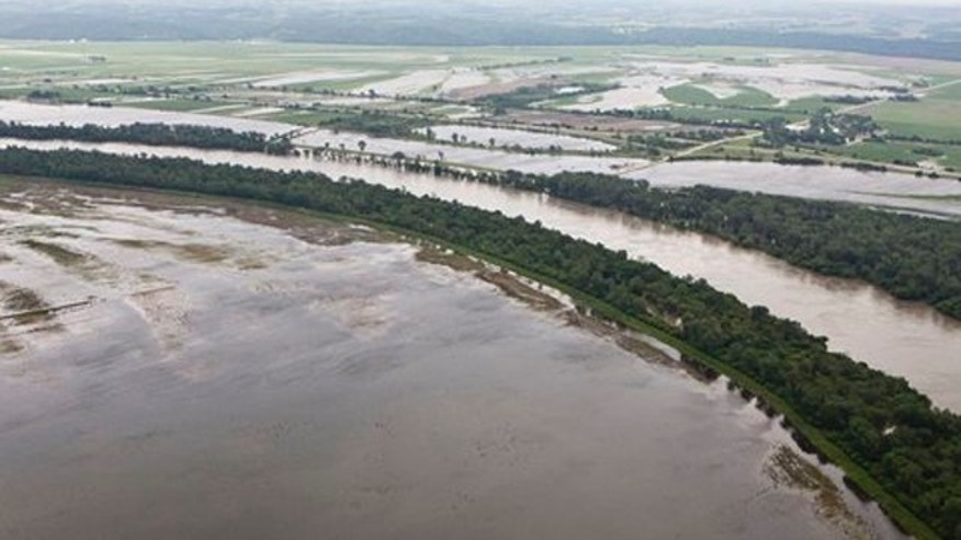 FILE - In this photo the Missouri River floods farmland north of Hamburg, Iowa.