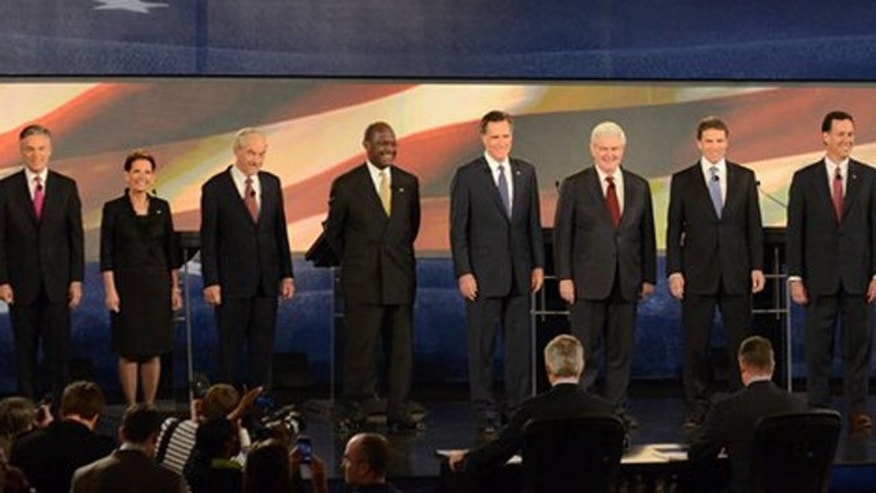 From left, Republican presidential candidates, Jon Huntsman, Former Governor of Utah, Michele Bachmann, U.S. Representative from Minnesota, Ron Paul, U.S. Representative from Texas, Herman Cain, Businessman, Mitt Romney, Former Governor of Massachusetts, Newt Gingrich, Former Speaker of House, Rick Perry, Texas Governor, and Rick Santorum, Former U.S. Senator, prepare to speak at the CBS News/National Journal foreign policy debate.
