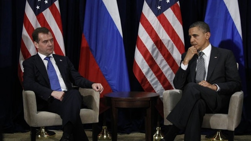 Nov.  12, 2011: President Obama and Russian President Dmitry Medvedev listen to translation during their meeting at the APEC Summit in Honolulu.