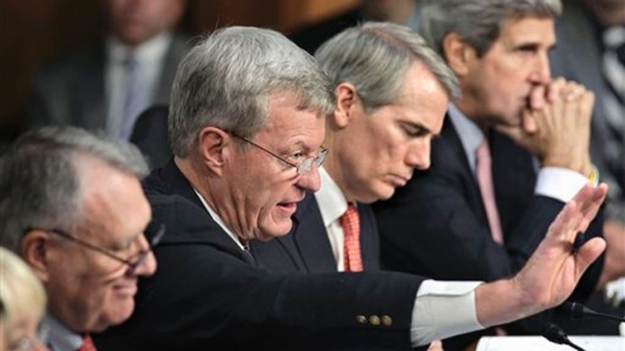 Oct. 26, 2011: Members of the deficit Super Committee meet on Capitol Hill. From left are Sen. Jon Kyl, Sen. Max Baucus, Sen. Rob Portman, and Sen. John Kerry.