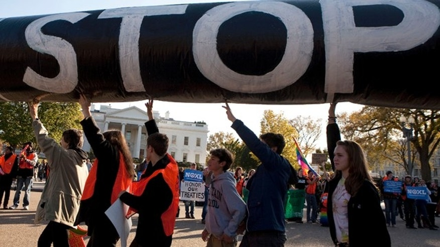 FILE: Nov. 6, 2011: Demonstrators call for the cancellation of the Keystone XL pipeline a rally in front of the White House, in Washington, D.C.