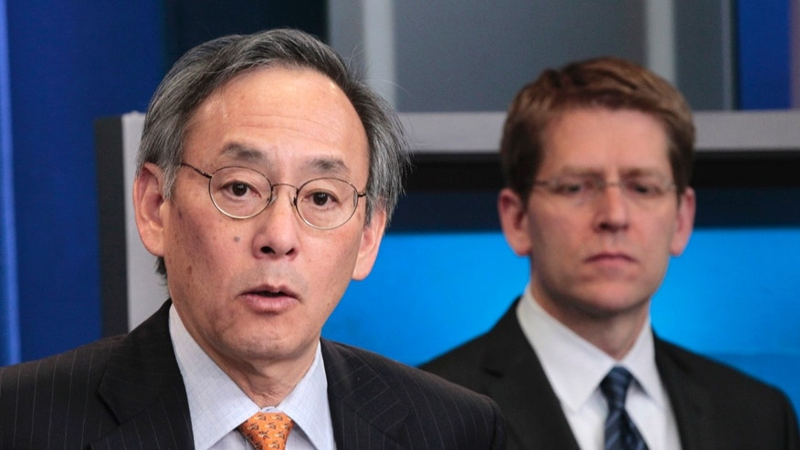 FILE: In this March, 30, 2011, photo, Energy Secretary Steven Chu, left, accompanied by White House Press Secretary Jay Carney, speaks during the daily news briefing at the White House in Washington.