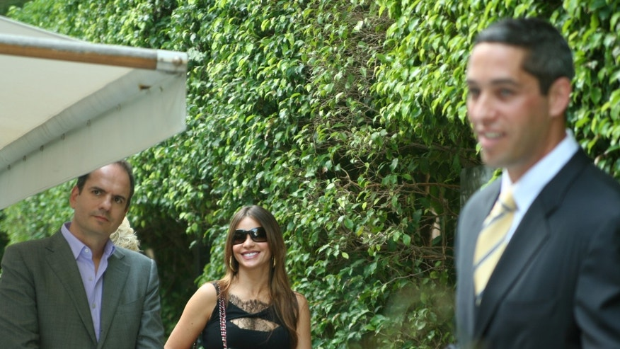 A smiling Sofia Vergara with her boyfriend, Nick Loeb, at a Miami Beach hotel shortly before he announced he did not want to run for senate. There had been much speculation that he wanted to run for statewide office.