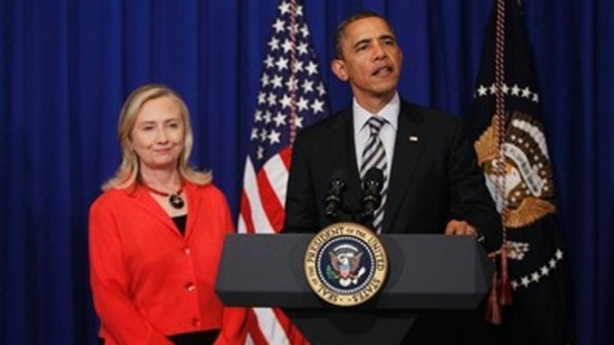November 18, 2011: U.S. President Obama stands with Secretary of State Hillary Clinton as he announces that she will travel to Burma, on the sidelines of the ASEAN and East Asia summit in Nusa Dua, on the island of Bali, Indonesia.