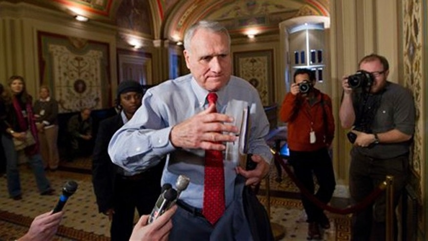 Nov. 18, 2011: Sen. Jon Kyl arrives for a meeting with the bipartisan members of the deficit Super Committee on Capitol Hill in Washington.