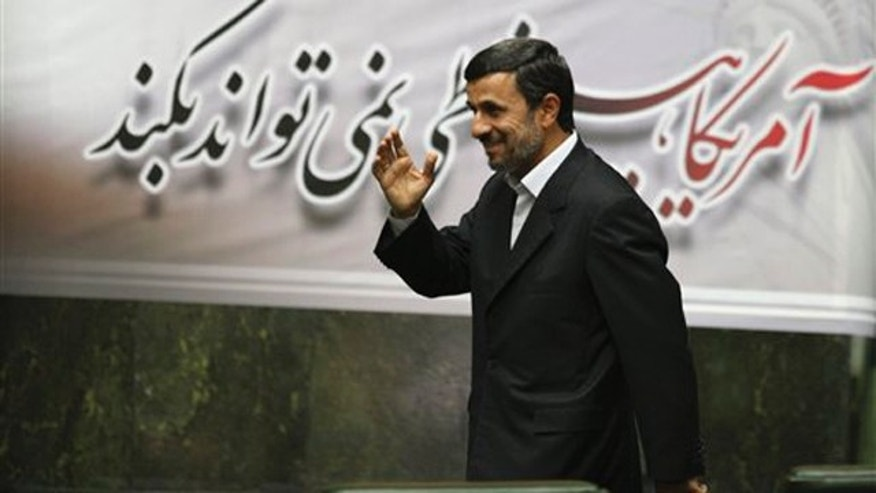 Nov. 1, 2011: Iranian President Mahmoud Ahmadinejad waves as he arrives to attend an open session of parliament in Tehran, Iran.
