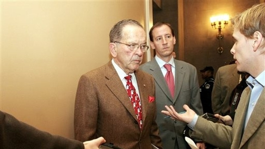 FILE - In this Dec. 19, 2005, file photo, Sen. Ted Stevens, R-Alaska, talks to reporters on Capitol Hill. Stevens died in a plane crash in August 2010 after leaving Congress and having a corruption conviction tossed out in April 2009.